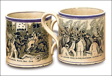 \one side of the mug  (shown on the left) commemorates the burning down of the Raynsford Jacksons' house in 1878 (courtesy of the BBC website and Blackburn Museum)