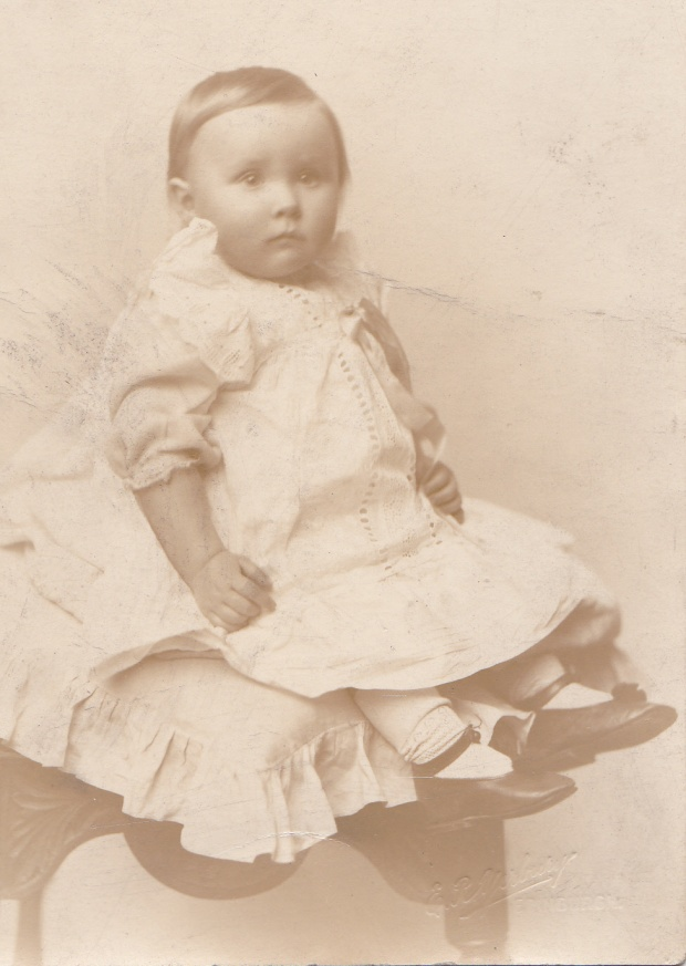 My mother, Christmas 1914. On the reverse of this postcard is written 'With Best Wishes for a Merry Xmas From Meg, Tom and the 'Wee Un'.