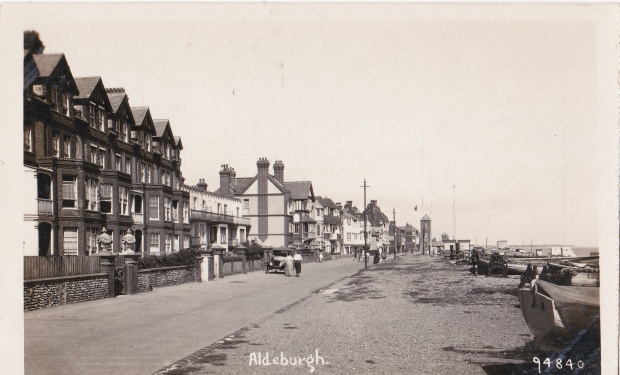 Crag Path, Aldeburgh. Brudenell Terrace, the row of tall houses on left, were built by Newson Garrett . Their red-brick gloom has now been transformed by pastel paints